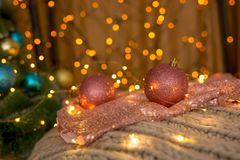 NChristmas balls coral color on the background of lights. stock photography