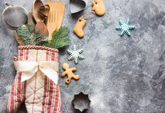 Christmas gift wrapping idea with oven mitt,kitchen utensils and cookies royalty free stock photo
