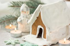 Christmas gingerbread village house tree. Christmas New Year`s background with snowflakes. Christmas card with gingerbread house C. NChristmas gingerbread Royalty Free Stock Image