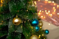 NChristmas tree decorated with blue and gold Christmas balls. royalty free stock image