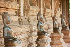 Ncient förkopprar Buddhastatyer lokaliserade förutom den tidigare templet för den Hor Phra Keo templet av Emerald Buddha i Vienti royaltyfri bild