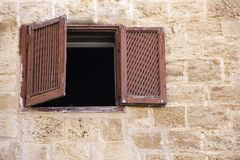 Аncient window with shutters in a stone house Stock Photography