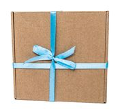 Gift box with bow isolated on white background. Ncraft gift box with blue bow on a white background for a holiday and giftn stock photography