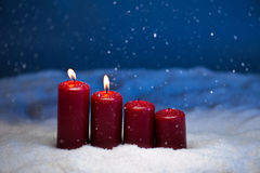 2nd Advent. Candles in snow and snowfall Stock Image