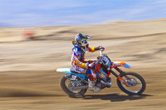 Speeding Dirt Biker Racer Stock Photos