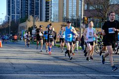 TORONTO, CANADA - May 5th, 2019 - 42nd Annual Toronto Marathon. People running through the city streets. royalty free stock photo