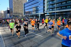 TORONTO, CANADA - May 5th, 2019 - 42nd Annual Toronto Marathon. People running through the city streets. stock images