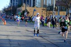 TORONTO, CANADA - May 5th, 2019 - 42nd Annual Toronto Marathon. People running through the city streets. stock photos