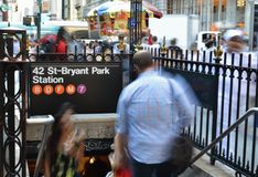 42nd Bryant Park Subway Entrance. 42nd Street New York City Bryant Park MTA Subway Entrance Sign Busy People royalty free stock photos