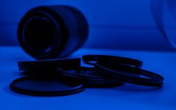 ND Filter with camera lens in blue light neutral-density filter. Group of ND Filter with camera lens in blue light neutral-density filter royalty free stock photos