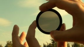 Nd filter lens. ND neutral lens filter for camera photographer stock footage