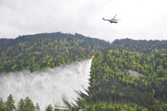 2nd International Firefighter Festival, Interlaken. Firefighters fighting a fire in the forest from the air. They filled the bucket with water from the local Royalty Free Stock Photography