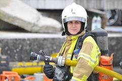 2nd International Firefighter Festival, Interlaken. Firefighter woman awaiting the next commands for the action. Ready to fight the fire with foam Stock Images