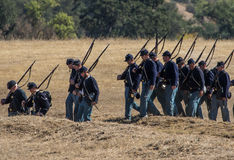 The 72nd New York. Union soldiers march into position during a Civil War reenactment at Hawes Farm in Anderson, California on October 4, 2015 Royalty Free Stock Photography