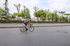 52nd Presidential Cycling Tour of Turkey. ISTANBUL, TURKEY - APRIL 24, 2016: Cyclist in Old Town of Istanbul during first stage of 52nd Presidential Cycling Tour Royalty Free Stock Photography