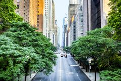 42nd street, Manhattan viewed from Tudor City. Overpass with Chrysler Building in background in New York City during sunny summer daytime at sunset stock photo