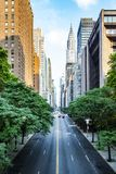 42nd street, Manhattan viewed from Tudor City. Overpass with Chrysler Building in background in New York City during sunny summer daytime at sunset royalty free stock photography