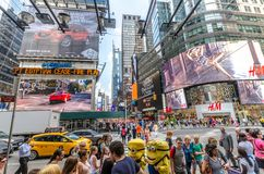 42nd Street. NEW YORK - JUL 22: 42nd Street near Times Square with traffic and commercials on July 22, 2014 in New York. 42nd Street is a major crosstown street royalty free stock images