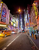 42nd Street. NEW YORK, USA - JUNE 28th 2014: Times Square and 42nd Street is a busy tourist intersection of neon art and commerce and is an iconic street of New Stock Photos
