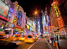 42nd Street. NEW YORK, USA - JUNE 28th 2014: Times Square and 42nd Street is a busy tourist intersection of neon art and commerce and is an iconic street of New royalty free stock image