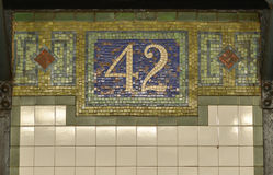 42nd Street NYC Subway Sign. 42nd Street - New York city subway sign tile mosaic pattern in midtown Manhattan stock photos