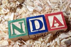 NDA text on wooden block royalty free stock image