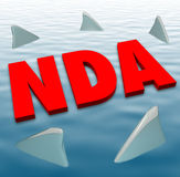 NDA Non Disclosure Agreement Sharks Danger Restriction Sharing S. NDA acronym in red 3d letters on water surrounded by circling sharks to illustrate danger of Stock Photo