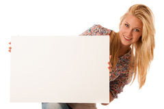 Nde woman holding a blank white board in her hands for promotion. Al text or banner isolated over white background Stock Image