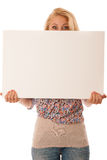 Nde woman holding a blank white board in her hands for promotion. Al text or banner isolated over white background Royalty Free Stock Images
