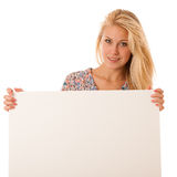 Nde woman holding a blank white board in her hands for promotion. Al text or banner isolated over white background Stock Photos