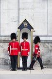 Ändern der Fuss-Abdeckungen am Regler-allgemeinen Haus Lizenzfreie Stockfotos