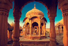 Ndia,Bada Bagh cenotaph in Jaisalmer, Rajasthan. Ancient Kings cemetery made of yellow sandstone at sunset stock photo