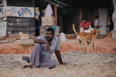 Ndian man on typical beach during ceremony on the Papanasam beach. Royalty Free Stock Photo