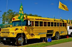 NDSU Bison Sports Bus. FARGO, NORTH DAKOTA: SEPTEMBER 20, 2013. The gold painted bus is in the tailgating parking lot and promotes the North Dakota State Royalty Free Stock Photo