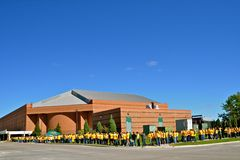 NDSU FargoDome Football. FARGO, NORTH DAKOTA: SEPTEMBER 20, 2013. The  North Dakota State University football fans line up in their gold T-Shirts to purchase Royalty Free Stock Images