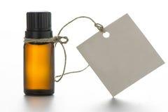 Nödvändig olja, tömmer etiketter Arkivbild