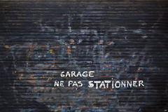 Ne pas stationner. A view of an old garage door Stock Photo