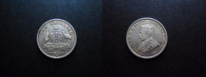 0ne Shilling Vintage Silver Coin 1916. The Reverse and the Obverse view of the 1916 0ne Shilling Vintage Silver Coin 1916. with King George V and the Australian Stock Image