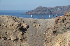 Nea Kameni, Santorini. Tourists on the volcano Nea Kameni which last erupted in the 1950`s Royalty Free Stock Photos