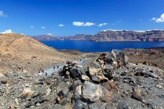 Nea Kameni volcanic island in Santorini, Greece Stock Photography