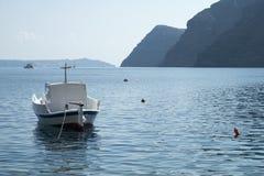 Nea Kameni. The volcanic island Nea Kameni seen across Santorini`s caldera from Thirasia Island stock images