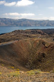 Nea Kameni Volcano Santorini. The cliffs of Santorini suround the sleeping volcano of Nea Kameni (which means New Volcano). It is one of Greeces many National stock photo