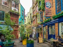 Neals Yard in London, England. LONDON UK - AUG 2: Neals Yard with unidentified people in August 2, 2017 in London, England. It is a small alley in Covent Garden Stock Image