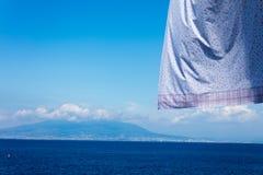 Neapolitan coast fron Sorrento with hanging clothes. Landscape of neapolitan coast fron Sorrento with hanging clothes stock photography