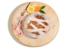 Neapolitan easter pie sprinkled with icing sugar and decorated with almond blossom and fresh fruits. Stock Photography
