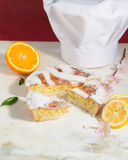 Neapolitan easter pie sprinkled with icing sugar and decorated with almond blossom and fresh fruits. Stock Photo