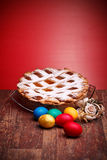 Neapolitan Pastiera And Colorful Easter Eggs Royalty Free Stock Photography