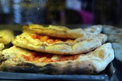 Neapolitan pizza close-up on a street display royalty free stock image