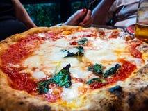 Neapolitan pizza margherita with mozzarella and tomato royalty free stock images