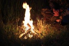 Near the the campfire Royalty Free Stock Photo